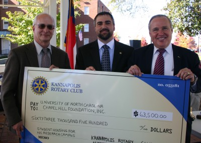 Dr. Zeisel receiving donation from Kannapolis Rotary Club