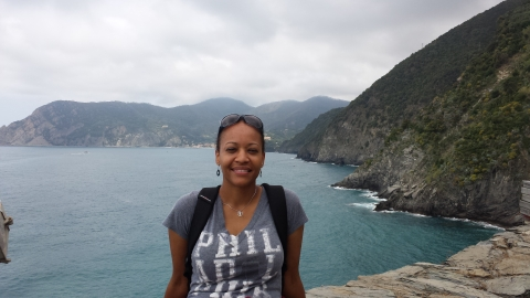 Folami hiking through Cinque Terre, Italy, stopping to samplesomelimoncello. Photo courtesy of Folami Iderraabdullah